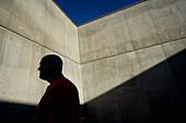 Prisoner behind Concrete Walls