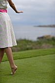 Barefoot Woman Walking on Lawn