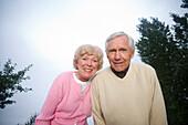 Senior Couple Smiling at Camera