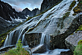 Flowing water from creek creating mini waterfall, Cirque of Unclimbables, Nahanni National Park, Northwest Territories