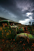 Storm Clouds over Old Abandoned Trucks, North Canol Road, Yukon