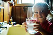 Little Girl Brushing her Teeth with a Glass of Water, Lake Muskoka, Bracebridge, Ontario