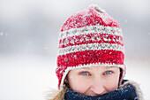 Woman bundled up, wearing toque on snowy winter day, Winnipeg, Manitoba