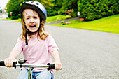 Girl riding bike and crying, Otterburn Park, Quebec