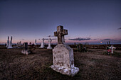 Sunset over a country cemetery in the hamlet of Fedora, Alberta