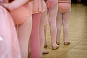 Little girls in ballet class.