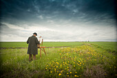 Man in Hat and Coat Painting in Field, Winnipeg, Manitoba