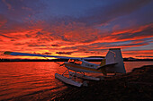 A float plane facing the sunrise over Teslin Lake, Yukon
