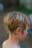 Young Boy with drops of water on his hair