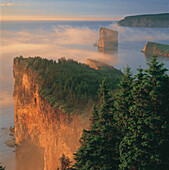 Perce Rock and the Three Sisters in Fog at Sunrise, Gaspe Peninsula, Quebec