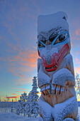 Snow Covered Totem Pole at Sunset, outside Teslin, Yukon