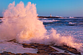 Strong Winds blow Waves onto Rocks in front of Lighthouse at Peggy's Cove, Nova Scotia