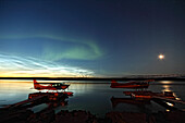 Aurora borealis and over the MacKenzie River with float planes in foreground, Fort Simpson, Northwest Territories