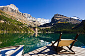 Chair on a dock, Lake O'Hara and Mountains, Yoho National Park, British Columbia