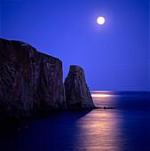 Moon at dusk on Perce Rock, Gaspe Coast, Quebec