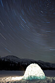 Igloo and star trails, Kusawa Lake, Yukon