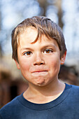 Portrait of young boy making a face, Gimli, Manitoba, Canada