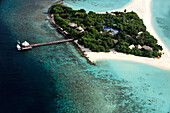 Republic of the Maldives, Ari Atoll, Madivaru Island, Banyan Tree Madivaru comprises 6 Tented Pool Villas. Each Tented Pool Villa is a set of three individual tents, distinctively equipped to function as living, sleeping, and bath areas, aerial view