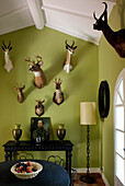 Green Dining room with hunting trophies on the walls