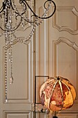 Lamp globe made of fabric in a French style apartment