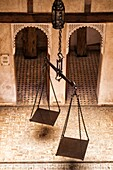 Kingdom of Morocco, Fes, Fes el Bali, Medina of Fes - listed by UNESCO as a world heritage site in 1981, Fondouk el-Nejjarine, Museum of Wooden Arts and Crafts, weighing scale in the courtyard