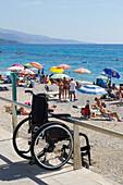 France, Provence-Alps-Côte d'Azur, Menton, Wheelchair on the beach