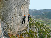 France, Aveyron department, Mostuejouls, Liaucous, men climbing on the Via Ferrata