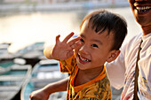 Portrait of a young boy smiling in Tam Coc, Northern of Vietnam, Vietnam, South East Asia, Asia