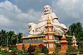 Happy Buddha statue in Vinh Trang Temple near My Tho, South Vietnam, Mekong Delta, South East Asia, Asia
