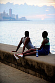 People relax at the Malecon in La Havana for sunset, Cuba