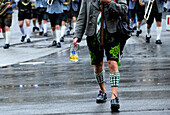 Close-up of music band dressed in traditional leather trousers and socks on Oktoberfest parade in Munich, Germany