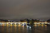 France, Paris, the Pont-Neuf and the western tip of the Ile de la Cité at night.