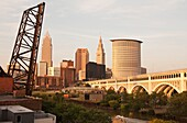 CUYAHOGA RIVER AT SETTLERS LANDING PARK DOWNTOWN SKYLINE CLEVELAND OHIO USA