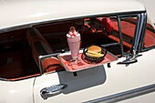 DRIVE IN FOOD TRAY ON 1950 WHITE CHEVROLET BEL AIR AUTOMOBILE