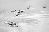 Cessna Caravan Amphibian Seaplane Flying Through The Coast Mountains, British Columbia Canada