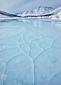 Cracked ice on the klondike river in tombstone territorial park, yukon canada