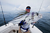 Man holding a roosterfish, panama