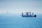 Men fishing from boat in boston harbor, boston massachusetts usa