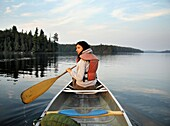 Woman Canoeing On A Lake