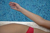 Young Woman Sunbathing By Swimming Pool, Mayan Riviera,Yucatan Peninsular,Quintana Roo State,Mexico