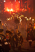 Lady With Children Dressed As Pirates Marching On The United Grand Procession On Bonfire Night Through The Streets Of Lewes, East Sussex, Uk