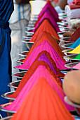 Rows Of Colorful Cone-Shaped Puga Pigment At Devaraja Market In Mysore, Karnataka, India