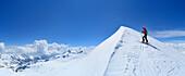 Female backcountry skier at ridge to summit of Monte Cevedale, Ortler range, Trentino-Alto Adige/Suedtirol, Italy