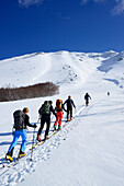 Group of persons back-country skiing ascending Monte Amaro, Rava Giumenta Bianca, Monte Amaro, Majella, Abruzzi, Apennines, l' Aquila, Italy
