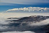 Monte Sirente above a valley with a sea of fog, Calascio, Abruzzi, Apennines, l' Aquila, Italy