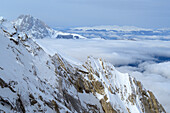 Gran Sasso standing above the snow-covered face of Monte Camicia, back-country skiing, Monte Camiscia, Val Vradda, Gran Sasso, Calascio, Abruzzi, Apennines, l' Aquila, Italy