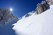 Sun gleaming over the snow-covered cirque at Monte Sirente, Valle Lupara, Monte Sirente, Abruzzi, Apennines, l' Aquila, Italy
