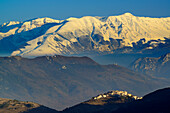 Village in front of snow-covered group of Majella with Monte Pesco Falcone and Monte Amaro, Abruzzi, Apennines, l' Aquila, Italy