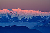 Snow-covered group of Majella with Monte Pesco Falcone and Monte Amaro in alpenglow, Abruzzi, Apennines, l' Aquila, Italy