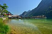Boat anchoring at landing stage of St. Bartholomae, St. Bartholomae, lake Koenigssee, Berchtesgaden range, National Park Berchtesgaden, Berchtesgaden, Upper Bavaria, Bavaria, Germany